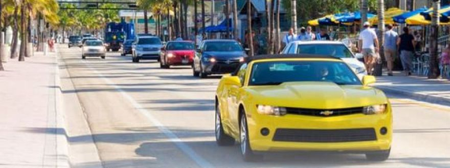 yellow chevy camaro on driving through South Florida beaches