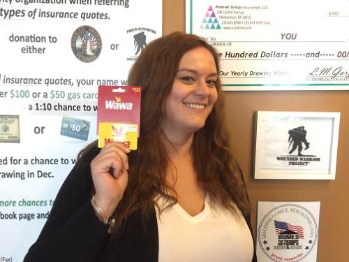 Kate Reber holding a gift card for winner Ms. Moneek Pines
