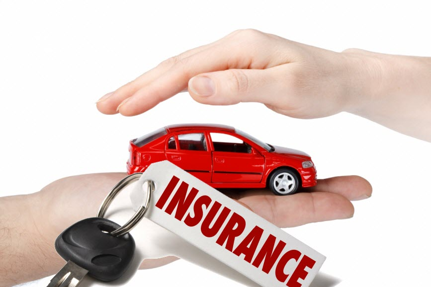 """Hands holding a red car and a key with a tag that says """"insurance"""""""
