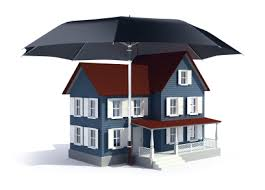 Model of a two story house under a black umbrella