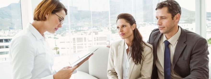 couple meeting insurance agent