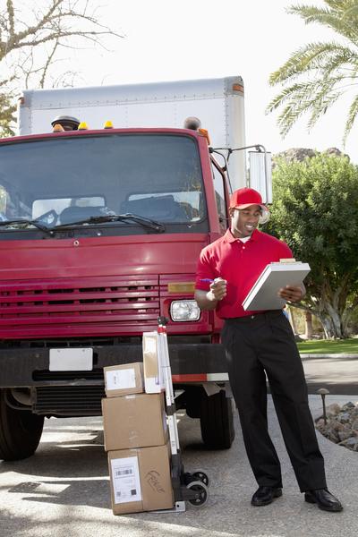 delivery man with truck - commercial truck insurance