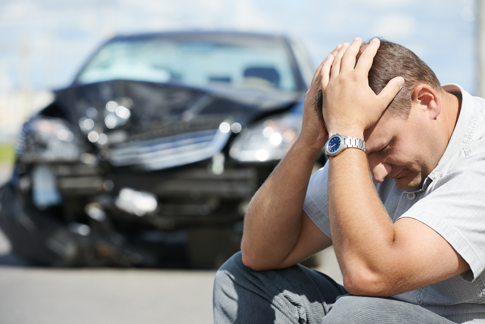man worried due to car accident