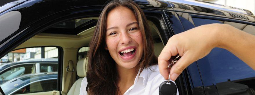 girl receiving keys to a new car