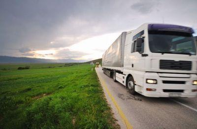 two Commercial Trucks Insured by Thumann Insurance