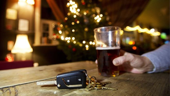 keys and a glass of beer at christmas